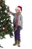 Niña sonriente con adorno de navidad — Foto de Stock