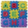 Alphabet puzzle pieces — Stock Photo