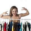 Angry woman choosing clothes — Stock Photo