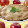 Apple pie garnished with leaves — Stock Photo #24278163