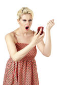 Angry woman looking at cellphone — Stock Photo
