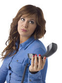 Annoyed woman with telephone — Stockfoto