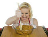Angry woman mixing cookie dough — Stock Photo
