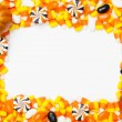 Arranged candy corns and pumpkins — Stock Photo
