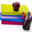 Art materials and an apple — Stock Photo #24281199