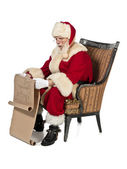 A reading santa clause — Stock Photo
