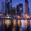 Business area Moscow City. Night view over the river. — Stock Photo