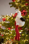 Post card with white stork on a new year tree — Stock Photo