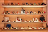Shoes and bags on the shelves in the store — Stock Photo