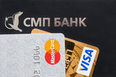 Logotype and name of SMP bank and Visa and Mastercard — Stock Photo