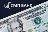 Logo of SMP bank and 20 dollar banknote — Stock Photo