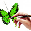 Woman's hand is painting a vivid green butterfly with a fountain pen — Foto Stock