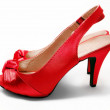 Red high-heeled shoes / stilettos / pumps / with a bow on white background - Stock Photo