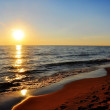 Stock Photo: Colorful, vivid sunset at / on the beach / ocean / sea / lake