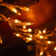 Stock Photo: Abstract background of glowing Christmas lights decoration in orange and yellow
