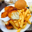 Stock Photo: Delicious battered breaded fish on plate with french fries, coleslaw salad and ketchup fish fry