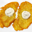 Potato pancakes with sour cream isolated on white background - Stock Photo