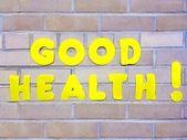 Lumineux jaune bonne santé signe symbole titre concept en soins de santé brique mur soins — Photo