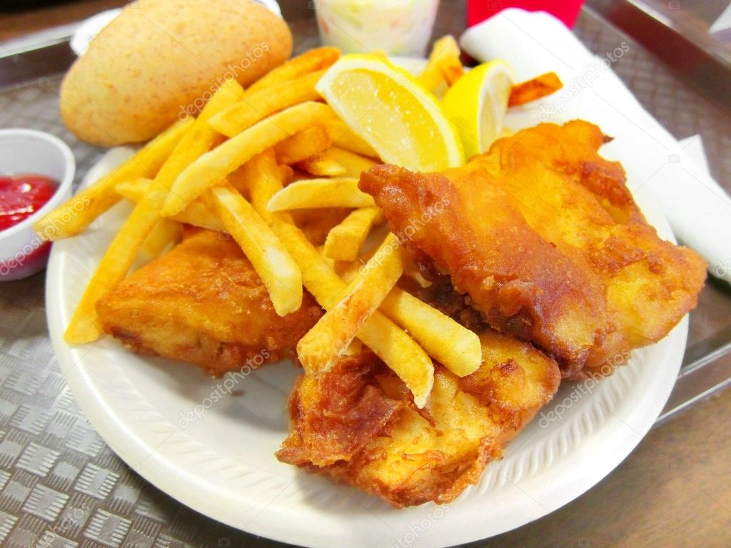 Delicious battered breaded fish on a plate with french for What goes good with fried fish