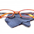 Fashionable orange eyeglasses glasses and cleaning cloth isolated on white background — Stock Photo
