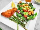 Health meal dinner lunch on white plate with fish salmon trout and greens veggies — Stock Photo
