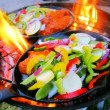 Sizzling healthy fajita chicken beef pork and veggie dinner barbecue grill cookout on a plate — Stock Photo #28421403