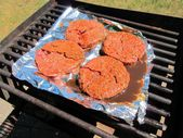 Hamburgers beef meat grilled barbecue outdoor cookout — Stock Photo