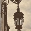 Vintage retro style lamp post lamppost pigeons birds — Stock Photo #32896879