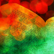 Old retro vintage open Bible Scripture Torah book and blurred blurry Christmas candle fairy light lights colorful abstract background wallpaper — Stok fotoğraf