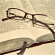 Stock Photo: Old sepiantique retro vintage book Bible Scriptures and glasses Christian