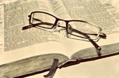 Old sepia antique retro vintage book Bible Scriptures and glasses Christian — Stock Photo