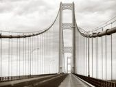 Large retro Mackinac Bridge steel, metal suspension bridge in Michigan USA in sepia — Zdjęcie stockowe