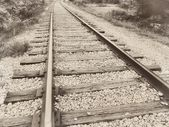 Close up closeup of a speedway railroad old rail railroad track vintage retro sepia — Stock Photo