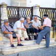 Elderly men socialising at the town square — Stock Photo