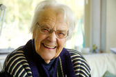 Elderly woman looking at the camera and smiling — Stock Photo