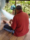 Terengganu, Malaysia : A fisherman repairing his fishing net — Stock Photo