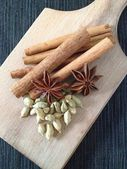 Spices on a wooden plate. — Stock Photo