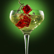Champagne glass and dice over green background — Stock Photo #12886082
