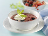 Fruit soup with cream — Stock Photo