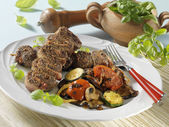 Beef rolls with grilled vegetables — Stock Photo