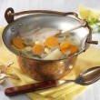 Tarragon pheasant soup in cauldron — Stock Photo