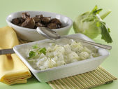Sour creamed kohlrabi cream with roasted chicken liver — Stock Photo