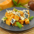 Honeydew melon with basil and cheese - Stock Photo