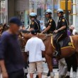 Crowd scene, NYPD officers on horseback, Time Square New York City - Stock Photo