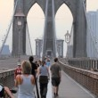 Stock Video: Pedestrians on Brooklyn Bridge, New York City