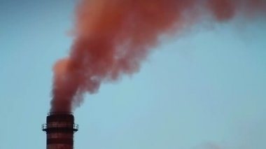 Smoke from the chimney of a ferronickel factory polluting the environment. — Stock Video