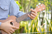 Child Play the ukulele — Stock Photo