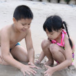 Children playing in sand — Stock Photo #43569759