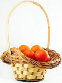 Cherry tomatoes in a basket — Stock Photo