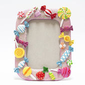 Picture frame with candy — Stock Photo